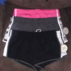 Three pairs of running shorts size med 2 are new